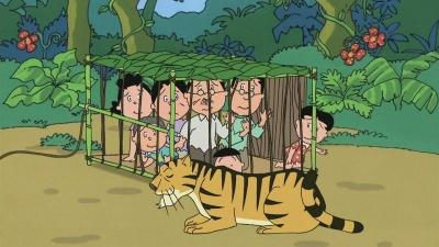 草の檻の中でトラに怯えるサザエさん一家
