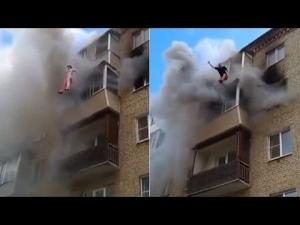 【危機一髪!】ロシアの火事現場で奇跡の救出劇!
