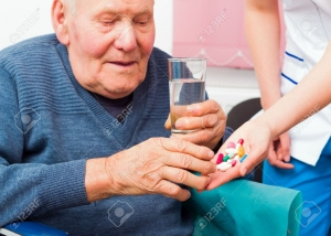 39689671-Senile-elderly-man-taking-daily-medicine-at-the-nursing-home--Stock-Photo.jpg