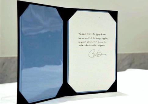 5月27日 産経 オバマ大統領が記帳した芳名録